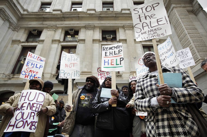 **FILE** Sheila Lloyd (right), who is facing foreclosure, stands March 24, 2011, outside City Hall in Philadelphia. (Associated Press)