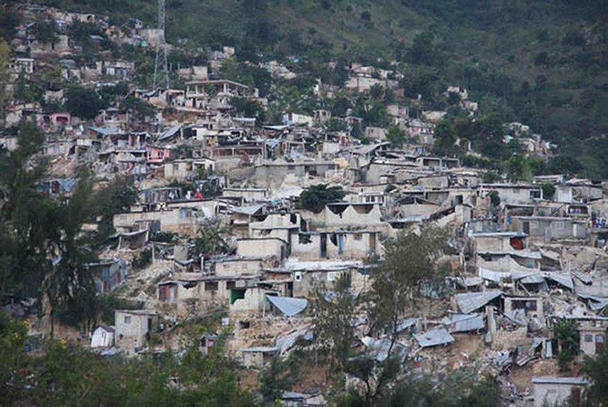 **FILE** This image made available by the American Red Cross shows earthquake damage to a shanty town on the outskirts of Port-au-Prince, following a major earthquake in Haiti, on Jan. 12, 2010. (Associated Press/American Red Cross)