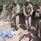 "**FILE** This image made on Jan. 12, 2012, from an undated video posted on the Internet by a YouTube user self-identified as ""semperfiLoneVoice"" shows men in U.S. Marine combat gear standing in a semicircle over three bodies. U.S. Defense Secretary Leon E. Panetta branded as ""utterly despicable"" the video purporting to show four U.S. Marines urinating on the corpses of Taliban fighters. (Associated Press)"