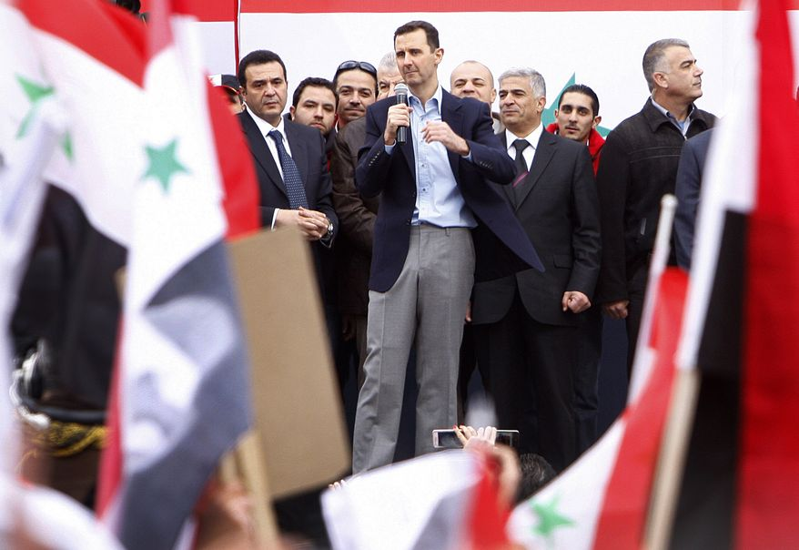 Syrian President Bashar Assad (center) addresses supporters Jan. 11, 2012, during a rally at a central square in Damascus, Syria. (Associated Press)