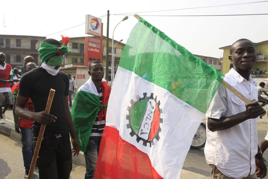 Angry youths protest Jan. 12, 2012, in Lagos, Nigeria, on the fourth day of a nationwide strike following the removal of a fuel subsidy by the government. A union representing 20,000 oil and gas workers threatened to shut down all production. (Associated Press)