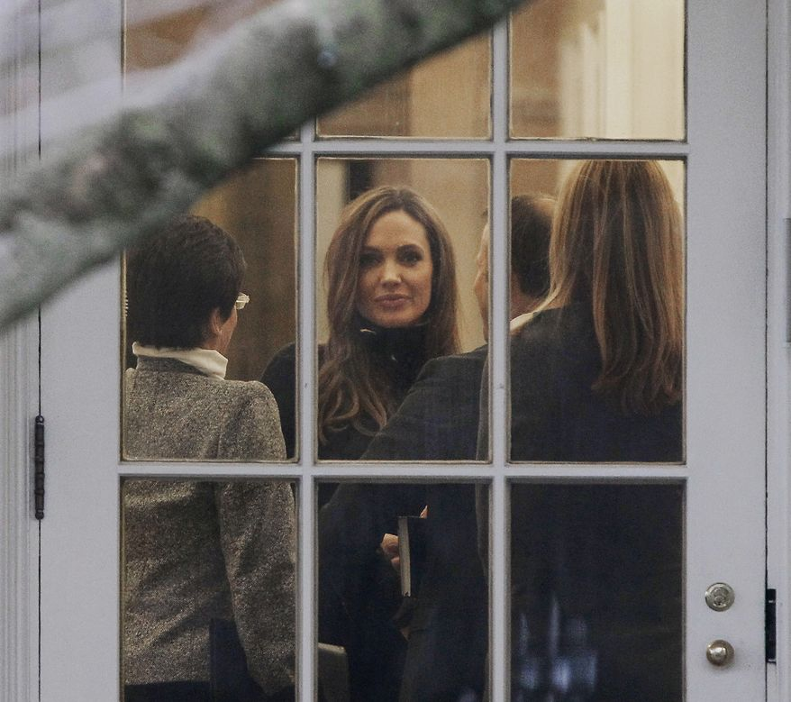 Actress Angelina Jolie is seen in the Oval Office of the White House on Jan. 11, 2012, during a meeting with President Obama. (Associated Press)