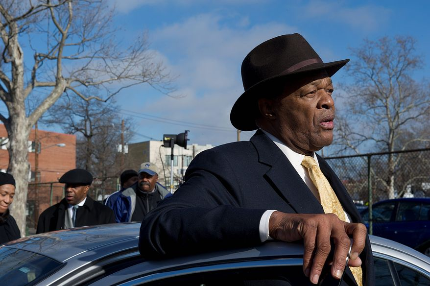 D.C. Council member Marion Barry arrives near the scene of the shootings of three male teens in Southeast Washington on Jan. 12. (Barbara L. Salisbury/The Washington Times)