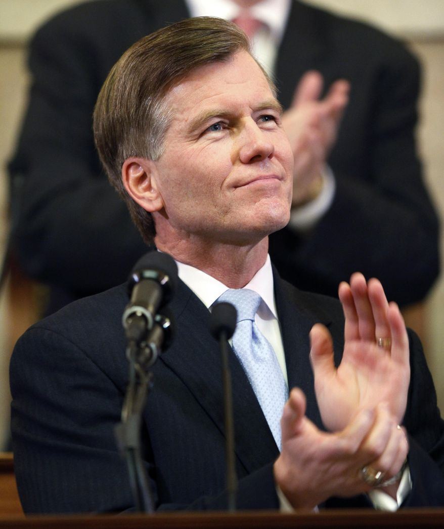 Virginia Gov. Bob McDonnell applauds as he delivers his State of the Commonwealth address before a joint session of the Virginia General Assembly in the House chambers at the Capitol in Richmond, Wednesday, Jan. 11, 2012. (AP Photo/Steve Helber)