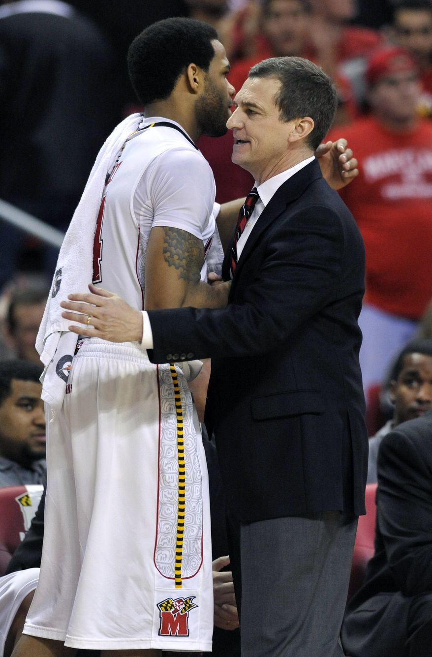 Maryland head coach Mark Turgeon hugs Sean Mosely after defeating Wake Forest 70-64 on Wednesday, Jan. 11, 2012, in College Park, Md. (AP Photo/Gail Burton)