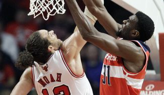 Washington Wizards forward Chris Singleton battles for a rebound against Chicago Bulls forward Joakim Noah during the first quarter in Chicago on Wednesday, Jan. 11, 2012. (AP Photo/Nam Y. Huh)
