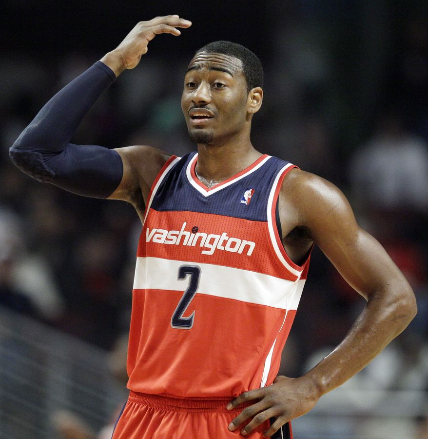 Washington Wizards guard John Wall (2) reacts after a teammate misses a basket during the first quarter of an NBA game against the Chicago Bulls in Chicago on Wednesday, Jan. 11, 2012. (AP Photo/Nam Y. Huh)
