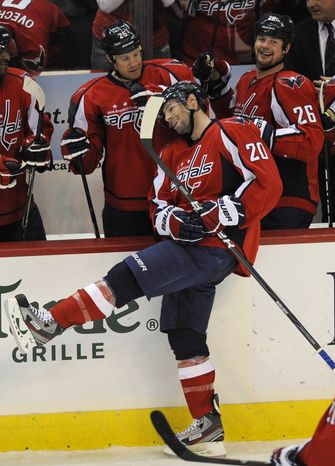 Washington Capitals left wing Troy Brouwer celebrates with teammates after he scored his third goal of the night during the third period against the Tampa Bay Lightning, Friday, Jan. 13, 2012, in Washington. The Capitals won 4-3. (AP Photo/Nick Wass)