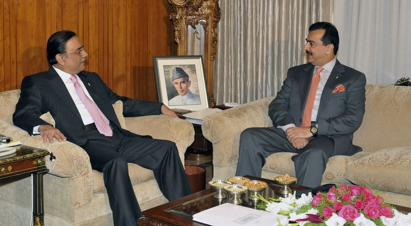 ** FILE ** In this Dec. 22, 2011, file photo released by Press Information Department, Pakistan's Prime Minister Yousuf Raza Gilani, right, talks with Pakistan's President Asif Ali Zardari during their meeting at President House in Islamabad, Pakistan. (AP Photo/Press Information Department, HO, File)