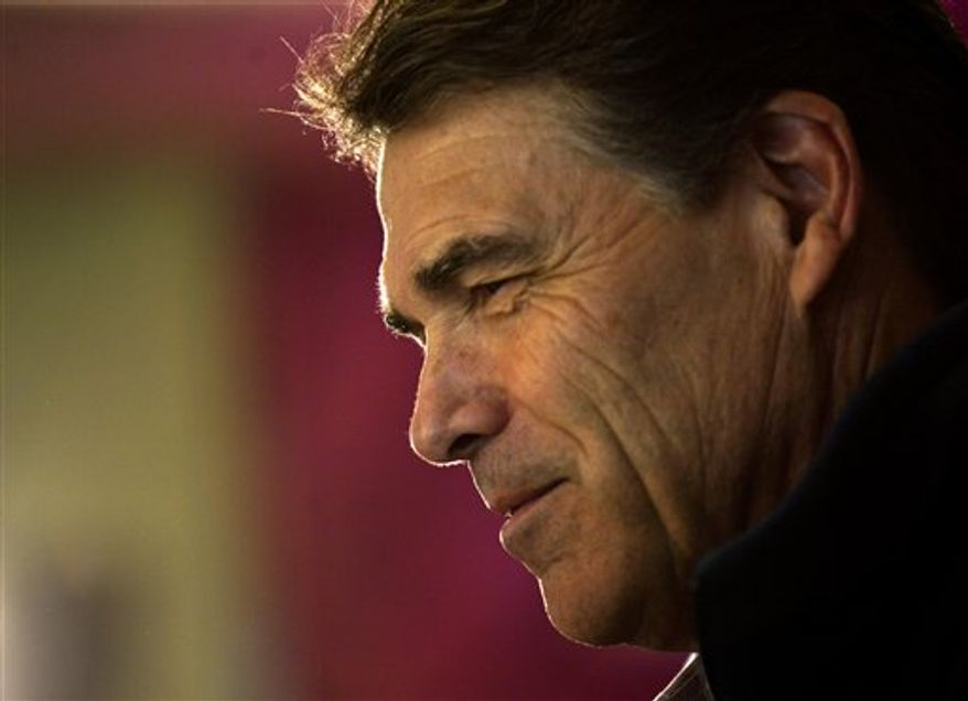 Republican presidential candidate Texas Gov. Rick Perry speaks at a campaign stop at the Hilton Head Diner Friday, Jan. 13, 2012, in Hilton Head, S.C. A federal judge refused to add Rick Perry and three others to the Virginia Presidential primary Friday. (AP Photo/David Goldman)
