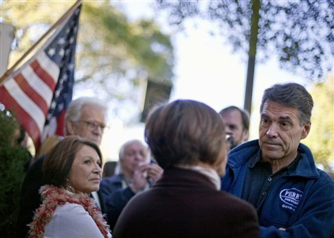 Republican presidential candidate and Texas Gov. Rick Perry greets people Jan. 12, 2012, during a campaign visit in Summerville, S.C. (Associated Press)
