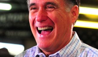 Republican presidential candidate Mitt Romney laughs as he meets supporters at Cherokee Trike and More in Greer, S.C., Thursday, Jan. 12, 2012. (AP Photo/Spartanburg Herald-Journal, Michael Justus)