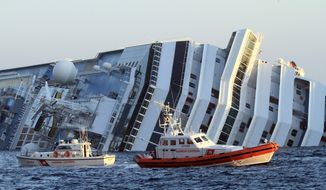 ** FILE ** The luxury cruise ship Costa Concordia leans on its side as after running aground off the tiny Tuscan island of Giglio, Italy, Saturday, Jan. 14, 2012. (AP Photo/Enzo Russo)