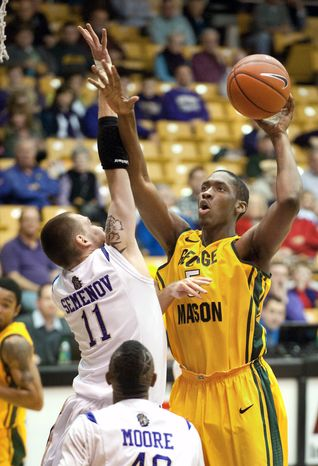 George Mason's Jonathan Arledge shoots over James Madison's Andrey Semenov in the second half Saturday, Jan. 14, 2012, in Harrisonburg, Va. He had 12 points and five rebounds in the 89-83 win. (AP Photo/The Daily News-Record, Michael Reilly)