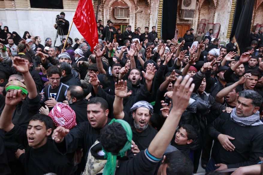 Shiite faithful pilgrims gather at the Imam Hussein Shrine in Karbala, for Arbaeen, which marks the end of the 45 mourning period after the anniversary of the 7th century martyrdom of Imam Hussein, the Prophet Muhammad's grandson, in Karbala, 80 kilometers (50 miles) south of Baghdad, Iraq, Friday, Jan. 13, 2012. (AP Photo/Hadi Mizban)