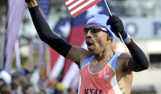 Meb Keflezighi reacts after winning the men's U.S. Olympic Trials Marathon Saturday, Jan. 14, 2012, in Houston. (AP Photo/David J. Phillip)