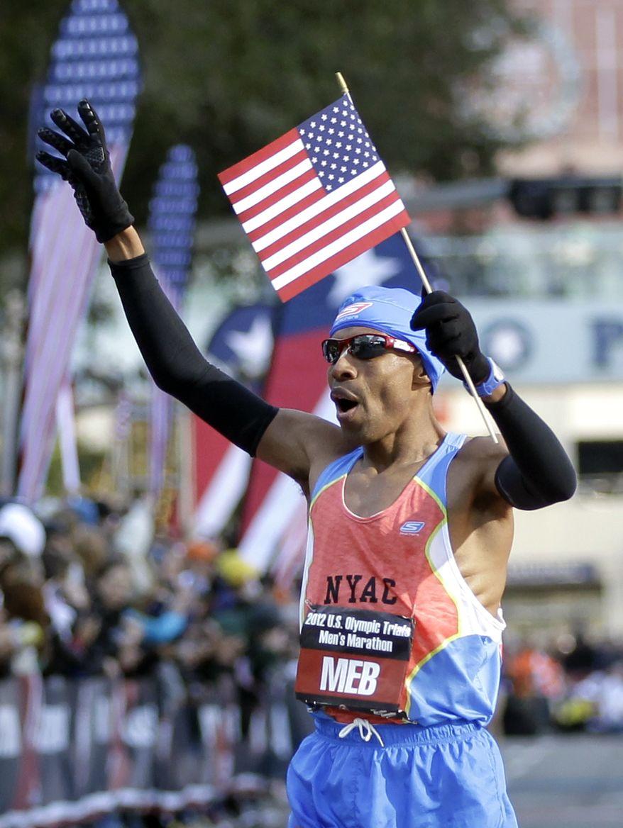 Meb Keflezighi reacts after winning the men's U.S. Olympic Trials Marathon Saturday, Jan. 14, 2012, in Houston. (AP Photo/David J. Phillip)