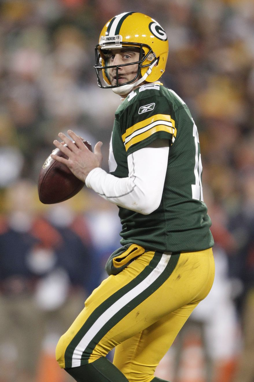 The last time the Packers faced the New York Giants in the playoffs, Brett Favre ended his Packers career with an interception in the NFC Championship game. Now the Packers and Aaron Rodgers boast one of the most accurate quarterbacks in the game with Rodgers, who will need to continue to avoid interceptions with the weather turning bad for the divisional playoff game scheduled for Jan. 15, 2012, against the Giants. (AP Photo/Morry Gash, File)