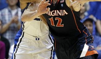 Duke's Andre Dawkins, left, and Virginia's Joe Harris chase a loose ball during the second half of in Durham, N.C., Thursday, Jan. 12, 2012. Duke won 61-58. (AP Photo/Gerry Broome)