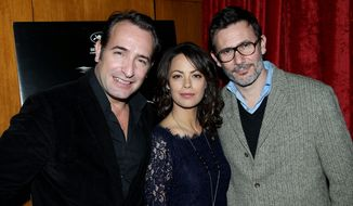 "Jean Dujardin (left) and Berenice Bejo (center) cast members in ""The Artist,"" directed by Michel Hazanavicius (right). Mr. Hazanavicius won a Critics' Choice Award for his work on the film. (Associated Press)"