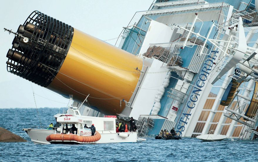 Italian firefighters conduct search operations Sunday on the luxury cruise ship Costa Concordia that ran aground off the tiny Tuscan island of Isola del Giglio, Italy. The accident sent water pouring in through a 160-foot gash in the hull and forcing the evacuation of some 4,200 people from the listing vessel early Saturday. (Associated Press)