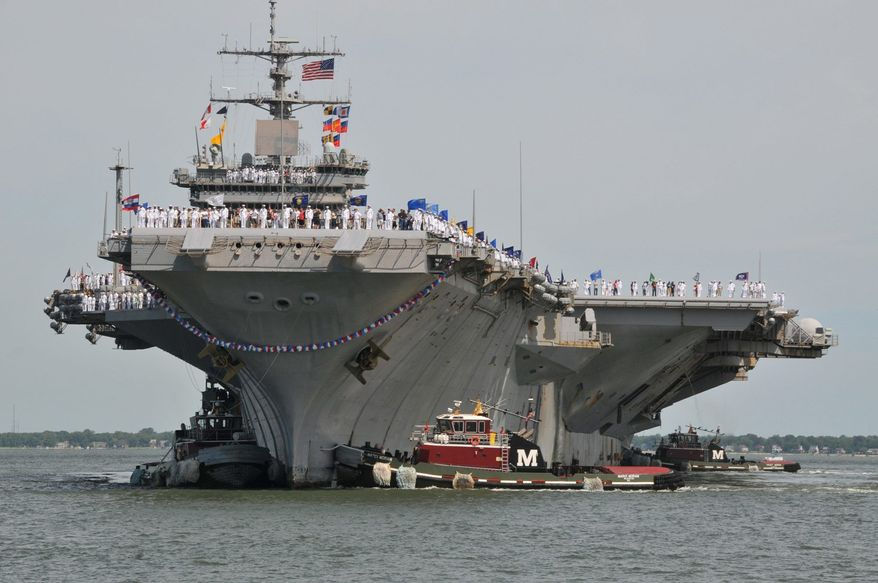 The USS Enterprise is among a fleet of 11 carriers that the Navy maintains by law, but Pentagon budget cuts have the service talking behind the scenes of protecting only 10 for future missions, sources say. (Associated Press)