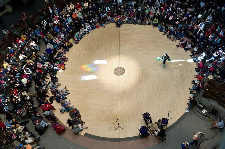 """Devin Kills Back, 15, a member of the Northern Cheyenne and Sioux tribes, performs a shawl dance at the Smithsonian's National Museum of the American Indian on Sunday as part of the Winter Storytelling Festival. """"This is getting back to our culture,"""" the group's founder Nellie Speelman says. """"People are more interested and realizing it's OK to be Indian."""" (Barbara L. Salisbury/The Washington Times)"""