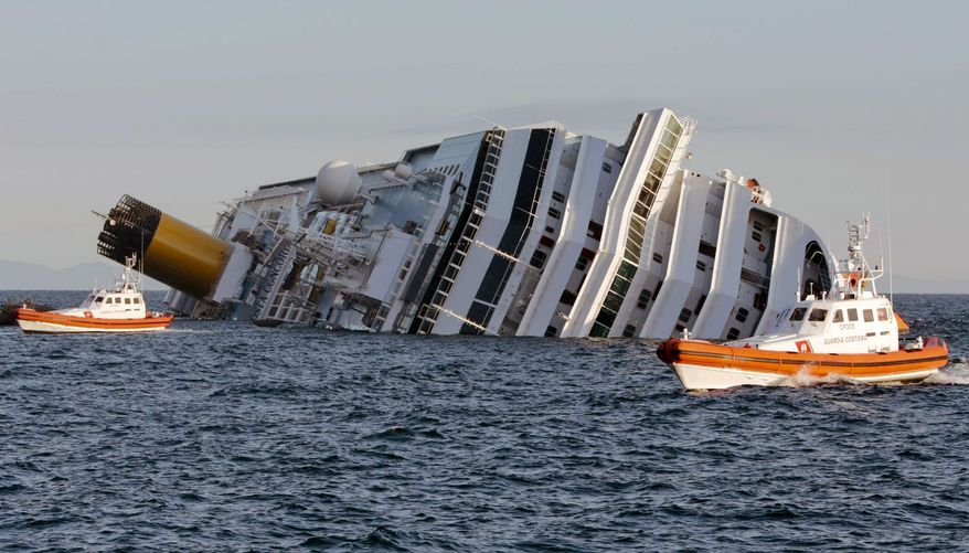 Rescuers approach the luxury cruise ship Costa Concordia on Sunday, Jan. 15, 2012, after the ship ran aground near the tiny Tuscan island of Isola del Giglio, Italy, on Friday night. (AP Photo/Gregorio Borgia)