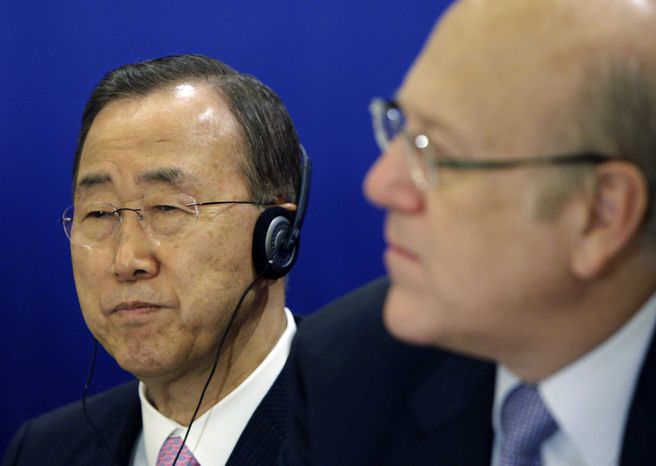 U.N. Secretary-General Ban Ki-moon (left) and Lebanese Prime Minister Najib Mikati attend the opening session of a conference on democracy in the Arab world in Beirut on Sunday, Jan. 15, 2012. (AP Photo/Bilal Hussein)
