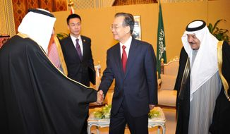 Chinese Premier Wen Jiabao (center) is welcomed by an unidentified Saudi official (left) as Saudi Crown Prince Nayef bin Abdel-Aziz (right) looks on before their meeting in Riyadh, Saudi Arabia, on Saturday, Jan. 14, 2012. (AP Photo/Saudi Press Agency)