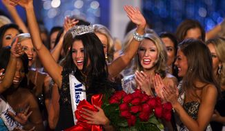 Laura Kaeppeler, Miss Wisconsin, reacts after being crowned Miss America on Saturday, Jan. 14, 2012, at the Planet Hollywood Resort & Casino in Las Vegas. (AP Photo/Eric Jamison)