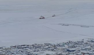 The U.S. Coast Guard icebreaker Healy guides the Russian tanker Renda closer to the fuel transfer mooring point off Nome, Alaska, on Saturday, Jan. 14, 2012. (AP Photo/U.S. Coast Guard, Petty Officer 2nd Class Charly Hengen)
