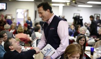 Former Pennsylvania Sen. Rick Santorum meets patrons of Tommy's Ham House in Greenville, S.C., on Saturday, Jan. 14, 2012, as he campaigns for the Republican presidential nomination. (AP Photo/Matt Rourke)