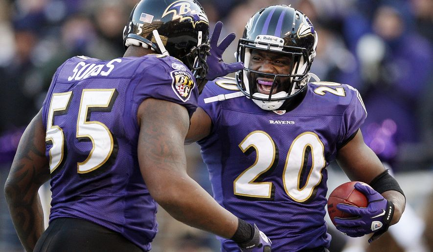 Baltimore Ravens free safety Ed Reed celebrates his interception with outside linebacker Terrell Suggs during the second half of a divisional playoff football game against the Houston Texans in Baltimore, Sunday, Jan. 15, 2012. The Ravens won the game 20-13. (AP Photo/Patrick Semansky)