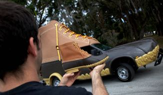 """The L.L. Bean """"Bootmobile"""" is ready to roll as the family-owned business marks its 100th birthday. Founder Leon Leonwood Bean sold his first pair of hunting boots in 1912 and expanded by selling only merchandise he liked and used. (L.L. Bean via Associated Press) ** FILE **"""