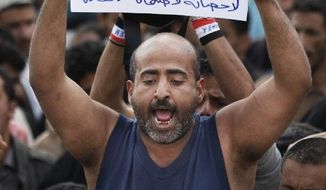 Protesters demand the prosecution of Yemeni President Ali Abdulla Saleh, who has been igniting unrest for a year. (Associated Press)