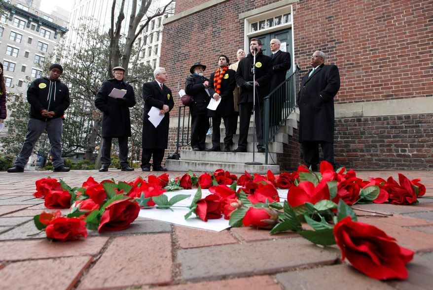 Gun control advocates, including Virginia Tech shooting victim Colin Goddard (at podium), rally at the bell tower at the Capitol in Richmond, on Monday. The roses scattered in the foreground represent Virginia gun violence victims. (Associated Press)