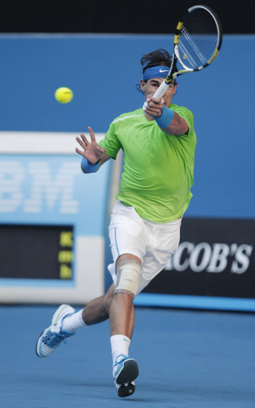 Rafael Nadal makes a forehand return to Alex Kuznetsov during their first-round match Jan. 16, 2012, at the Australian Open in Melbourne, Australia. (Associated Press)
