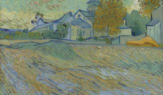 "Vincent van Gogh's autumn landscape ""Vue de l'Asile et de la Chapelle de Saint-Remy,"" from the collection of the late actress Elizabeth Taylor, is estimated to sell for 5 million to 7 million pounds ($7.6 million to $11 million) when auctioned by Christie's in London in February. (AP Photo/Christie's)"