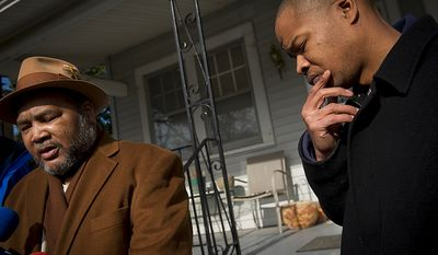 Emmanuel Dugger (right), joined by his father, Eugene, on Monday in front of their home in the 3000 block of Channing Street Northeast, talks about how his father helped him with an abandoned infant after the younger Mr. Dugger found the baby girl on his way home from the store. (Rod Lamkey Jr./The Washington Times)