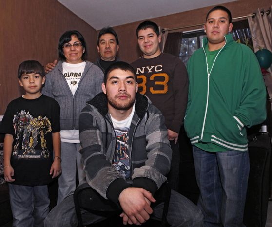 Jesus Gerardo Noriega (front) poses Jan. 4, 2012, with his parents and brothers at the family home in Aurora, Colo. Jesus, 21, faced deportation last year after he was arrested for driving with no license plate light. Noriega's family brought him to the United States from Mexico when he was 9. (Associated Press)