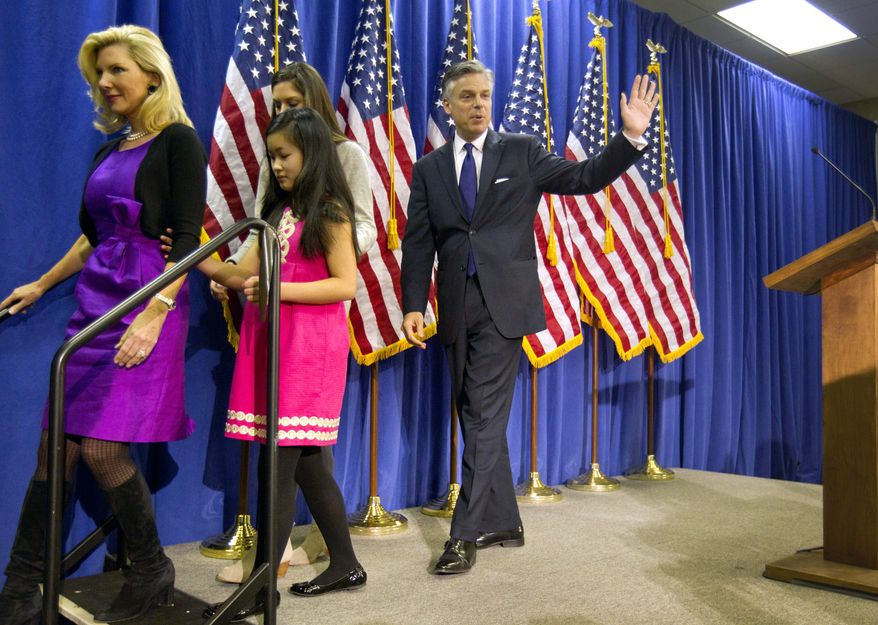 Former Utah Gov. Jon Huntsman walks off stage with his family Jan. 16, 2012, after announcing the withdrawal of his presidential candidacy in Myrtle Beach, S.C. From left are wife Mary Kaye and daughters Gracie and Abby. (Associated Press)