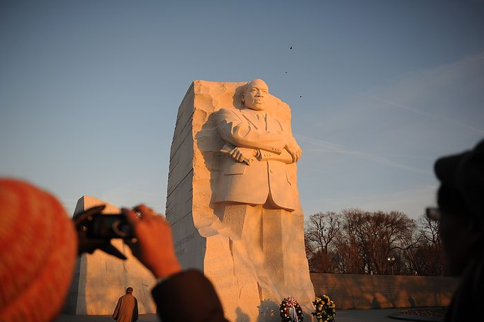 Visitors photograph the statue of Martin Luther King Jr. during the wreath-laying ceremony at the foot of the Stone of Hope at the Martin Luther King Jr. Memorial on the National Mall in Washington on Monday, Jan. 16, 2012. (Rod Lamkey Jr./The Washington Times)