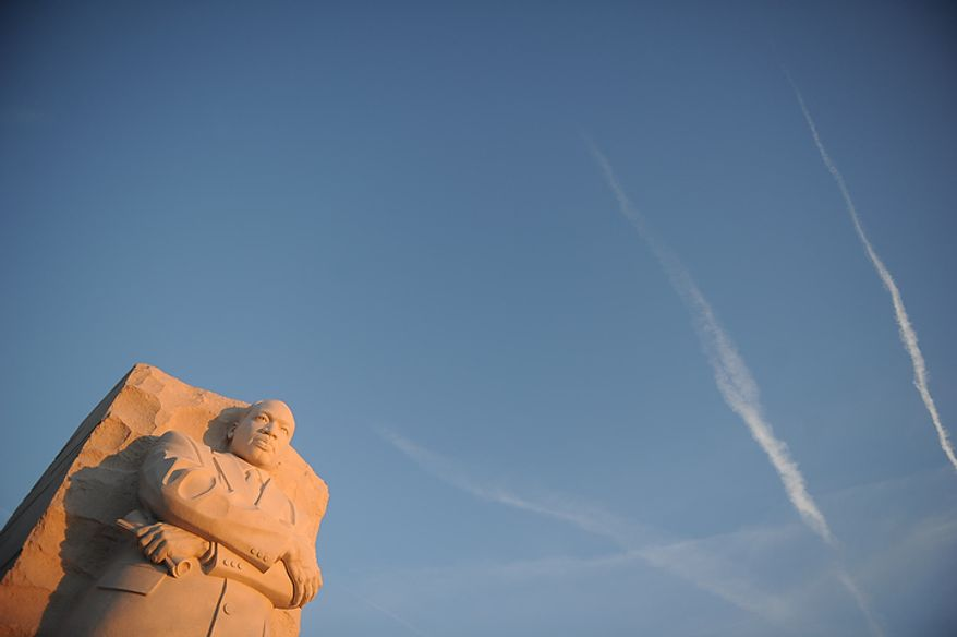 The Martin Luther King Jr. Memorial on the National Mall stands against a rising sun in Washington on Martin Luther King Day, Monday, Jan. 16, 2012. (Rod Lamkey Jr./The Washington Times)