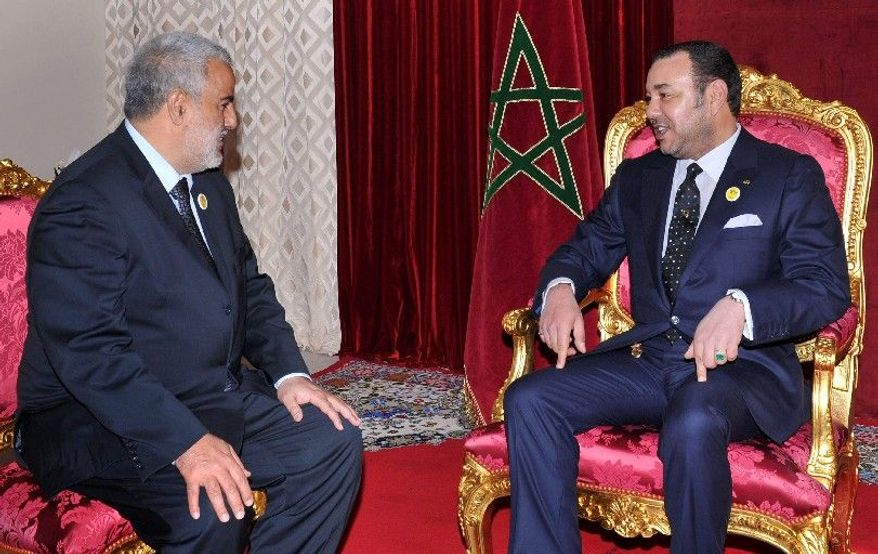 King Mohammed VI (right) met with Abdelilah Benkirane, Morocco's new prime minister, days after elections in November. All eyes will be on Mr. Benkirane and how he reacts to the growing power of the king's men. The king has made a flurry of appointments to his royal Cabinet in recent weeks, men who look poised to challenge the new government's power. (Associated Press)
