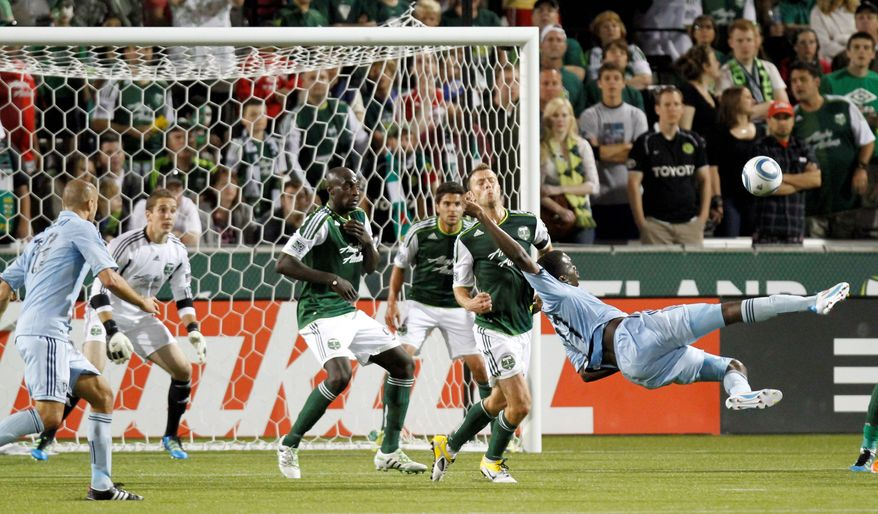 Forward C.J. Sapong, right, going airborne for a shot on goal, had five goals and five assists while playing in all 34 games. The 10th pick of the 2011 MLS SuperDraft started and scored against Chivas USA in the first match of the season. (Associated Press)