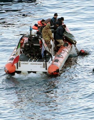 Italian divers recover one of five bodies Tuesday from the wrecked cruise ship Costa Concordia off the coast of Tuscany, raising the official death toll to 11. Teams have been searching the vessel for passengers and crew missing since the vacation liner foundered on rocks Friday evening. (Associated Press)