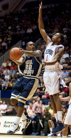 George Washington's Lasan Kromah (20) shoots around Richmond's Darrius Garrett (1) during second-half action in an NCAA college basketball game at the Robins center in Richmond, Va. Saturday, Feb. 20, 2010. Richmond went on to win 74-70. (AP Photo/Scott K. Brown)
