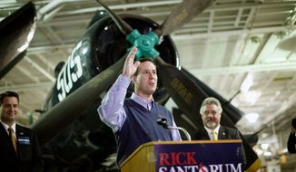 ** FILE ** Republican presidential hopeful Rick Santorum greets his audience at a gathering Tuesday on the USS Yorktown in Mount Pleasant, S.C. He is trying to convince voters in the run-up to the state's primary Saturday that he is the best conservative in the race. (Associated Press)