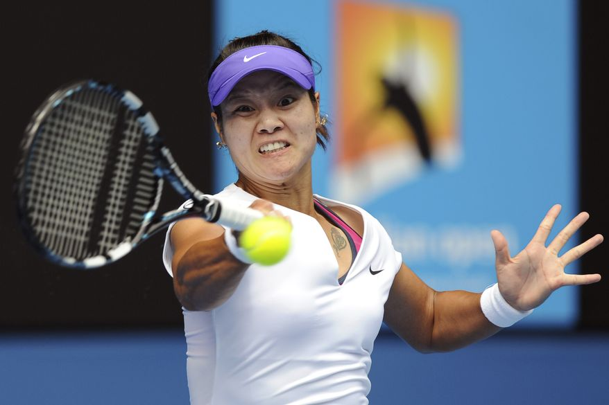 Li Na of China returns a ball to Australia's Olivia Rogowska during their second round match at the Australian Open tennis championship, in Melbourne, Australia, Wednesday, Jan. 18, 2012. (AP Photo/Andrew Brownbill)